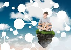 Boy on floating rock platform  in sky holding dog with connectors interface. Digital composite of Boy on floating rock platform  in sky holding dog with Royalty Free Stock Photography