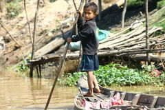 Boy in floating village in Cambodia Stock Photo