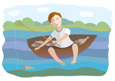 The boy floats in a boat and fishes Stock Image