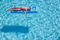 A boy floats on an inflatable mattress Royalty Free Stock Images