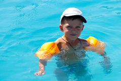 The boy floats in pool Stock Image