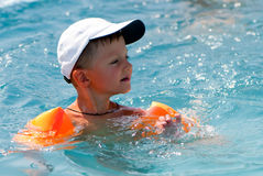 The boy floats in pool Royalty Free Stock Photography