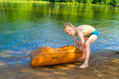 Boy floats on the river Stock Image