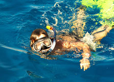 Boy floats in the sea Royalty Free Stock Photos