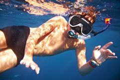Boy floats under water. In the sea Royalty Free Stock Photos