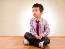 Boy on floor Stock Photo