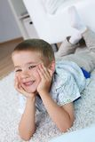 Boy on the floor Royalty Free Stock Photo
