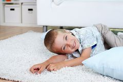 Boy on the floor Stock Image