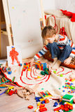 Boy on the floor plays varicoloured blocks Royalty Free Stock Images