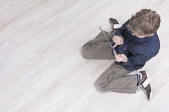 Boy on floor with tablet pc Stock Images