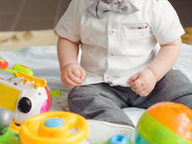 Boy on Floor with Toys Royalty Free Stock Photos