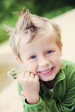 Boy with flower. 5 years old boy with flower outside - kids stock photo