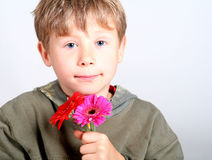 Boy with flowers. Young sweet boy with some flowers stock photos