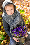 Boy with flowers Stock Image