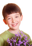 Boy with flowers. Boy with spring flowers in flowerpot Royalty Free Stock Photo