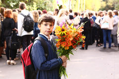 Boy with flowers celebrate first school day in Moscow. Stock Photo