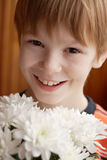 Boy with flowers Stock Photos