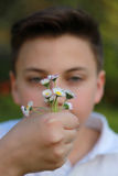 Boy with flowers Royalty Free Stock Image