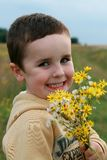 Boy with flowers for mummy Stock Photo