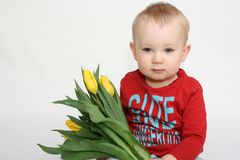 Boy with flowers for mummy Stock Image