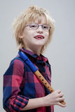 Boy with a flute Royalty Free Stock Photos