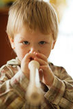 Boy with flute Stock Image