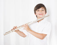 Boy with flute. Portrait of a boy holding a flute in his hands Stock Photo