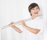 Boy with flute Stock Photos