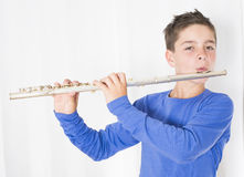 Boy with flute. Portrait of a boy playing the flute Stock Image