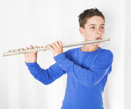 Boy with flute Stock Photos