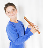 Boy with flute Royalty Free Stock Image