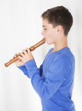 Boy with flute Stock Images