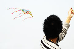 Boy fly a kite stock photo