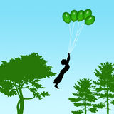 Boy flying balloons Stock Images