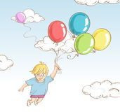 Boy flying with balloons Stock Image