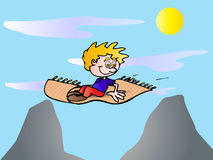 Boy on a flying carpet Royalty Free Stock Images