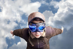 Boy flying, daydreaming he´s a pilot Stock Images