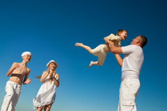 Boy flying on his father's hands. At beach Royalty Free Stock Photos