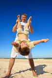 Boy flying on his parent 's hands. At beach Royalty Free Stock Photo