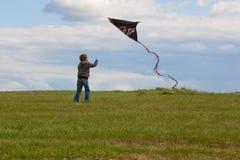 Boy flying Kite Royalty Free Stock Image