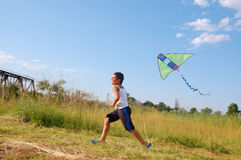 Boy flying a kite Stock Images