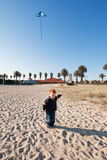 Boy flying kite on beach Royalty Free Stock Photography