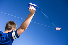 Boy Flying Kite. Child flying a kite in the clear blue sky Royalty Free Stock Photos