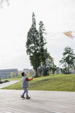 Boy flying kite Stock Images