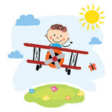 Boy flying over a field. Cartoon pilot boy on a airplane flying over green hill Stock Photo