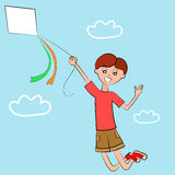 Boy flying in the sky, holding a kite Royalty Free Stock Image