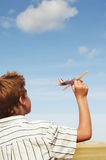 Boy Flying Toy Airplane On Beach Stock Photos