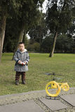 Boy flying toy helicopter Royalty Free Stock Images