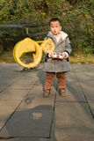 Boy flying toy helicopter Royalty Free Stock Photography