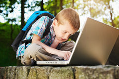 Boy focused on notebook Royalty Free Stock Photos